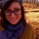 picture of a woman in a knitted hat standing outside in fall