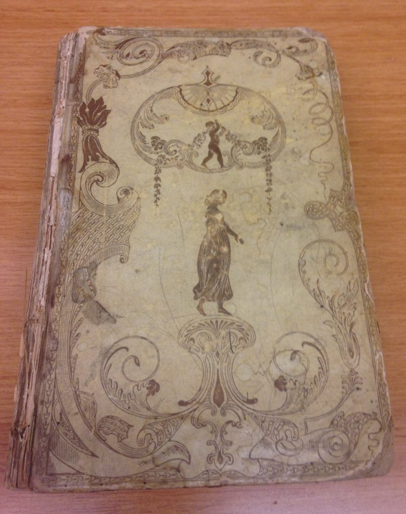book with light binding and imprint of woman on cover