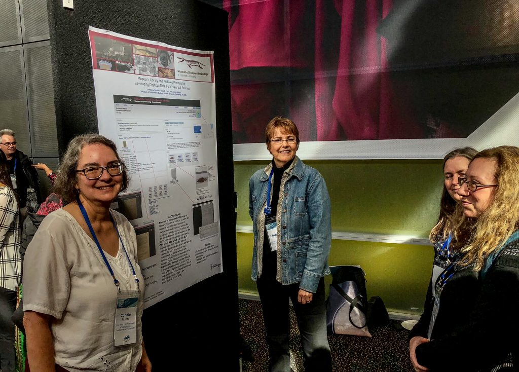 "Constance Rinaldo (left) with Linda S. Ford (right) presenting their poster: ""Museum, Library and Archives Partnership: Leveraging Digitized Data from Historical Sources""."
