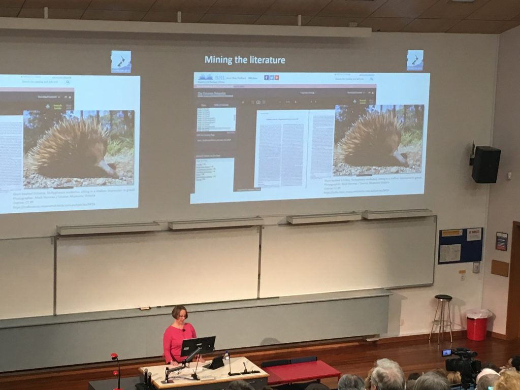 Dr. Elycia Wallis delivering a keynote address (with a highlight of BHL!) as part of the joint SPNHC/TDWG Conference.