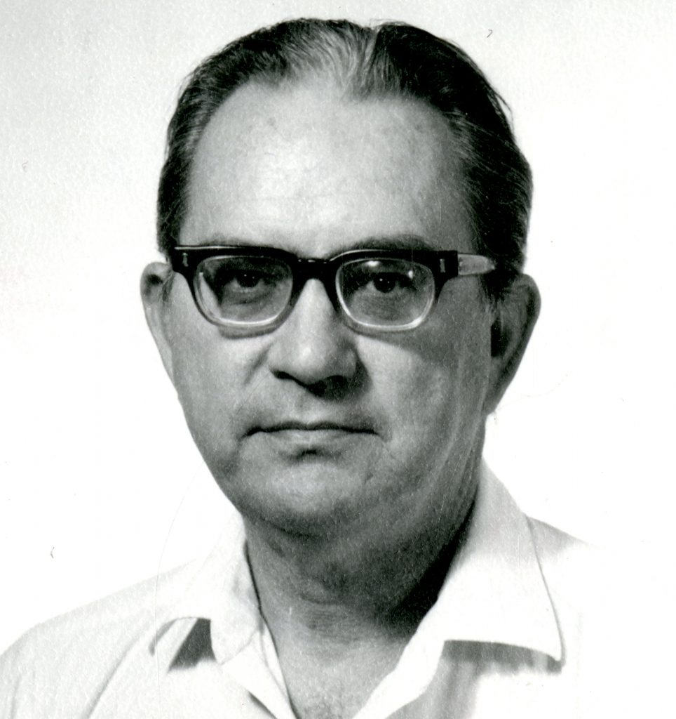 black and white image of a man in glasses, Dr. Peters
