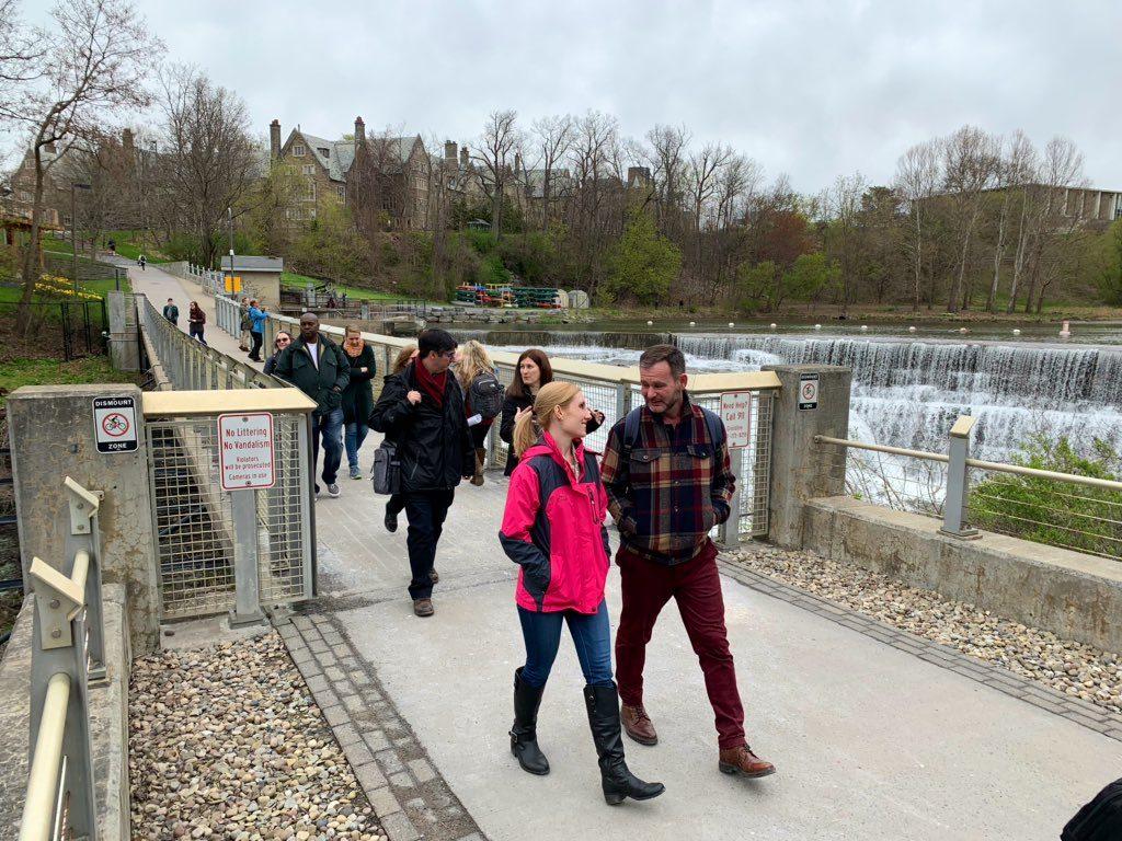 Group of people crossing a bridge.