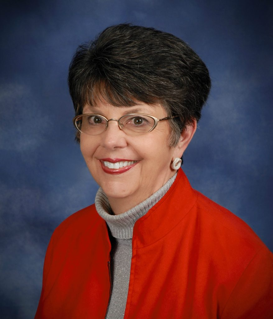 photo of a dark haired person in a red jacket