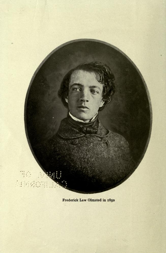 black and white portrait of a young man with short dark hair