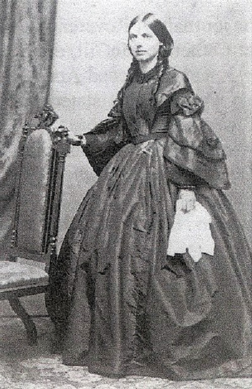 Black and white photo of a brunette person in a dress