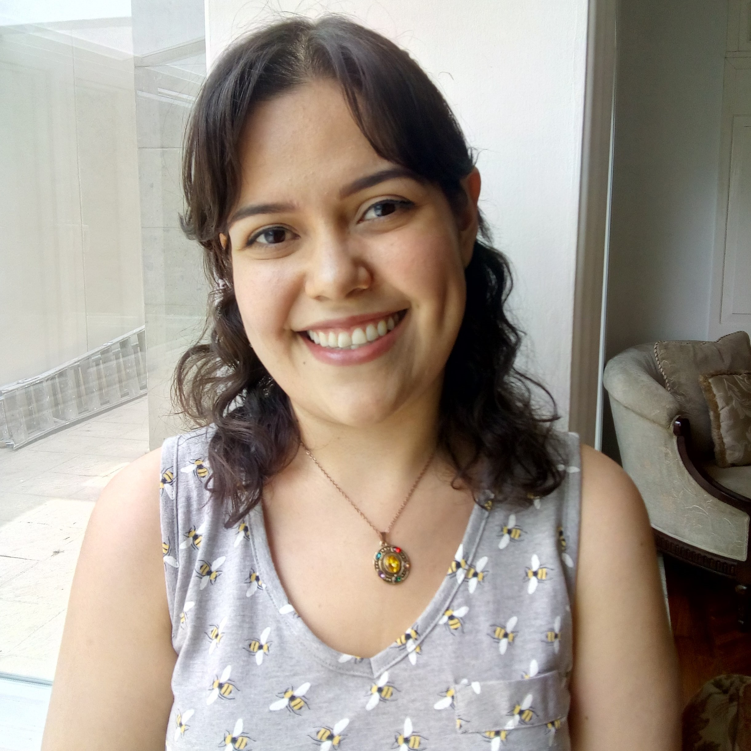 photo of a woman in a pale purple shirt with dark hair