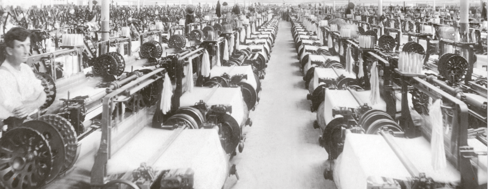 black and white photo of a textile mill weave room.