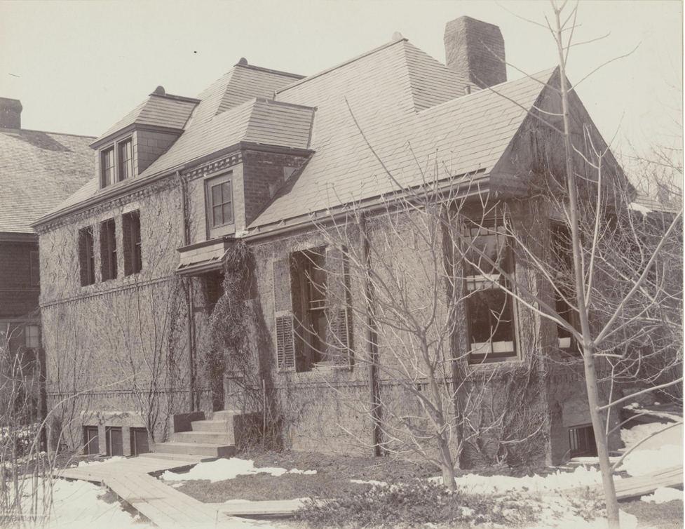 Black and white photograph of a brick house.