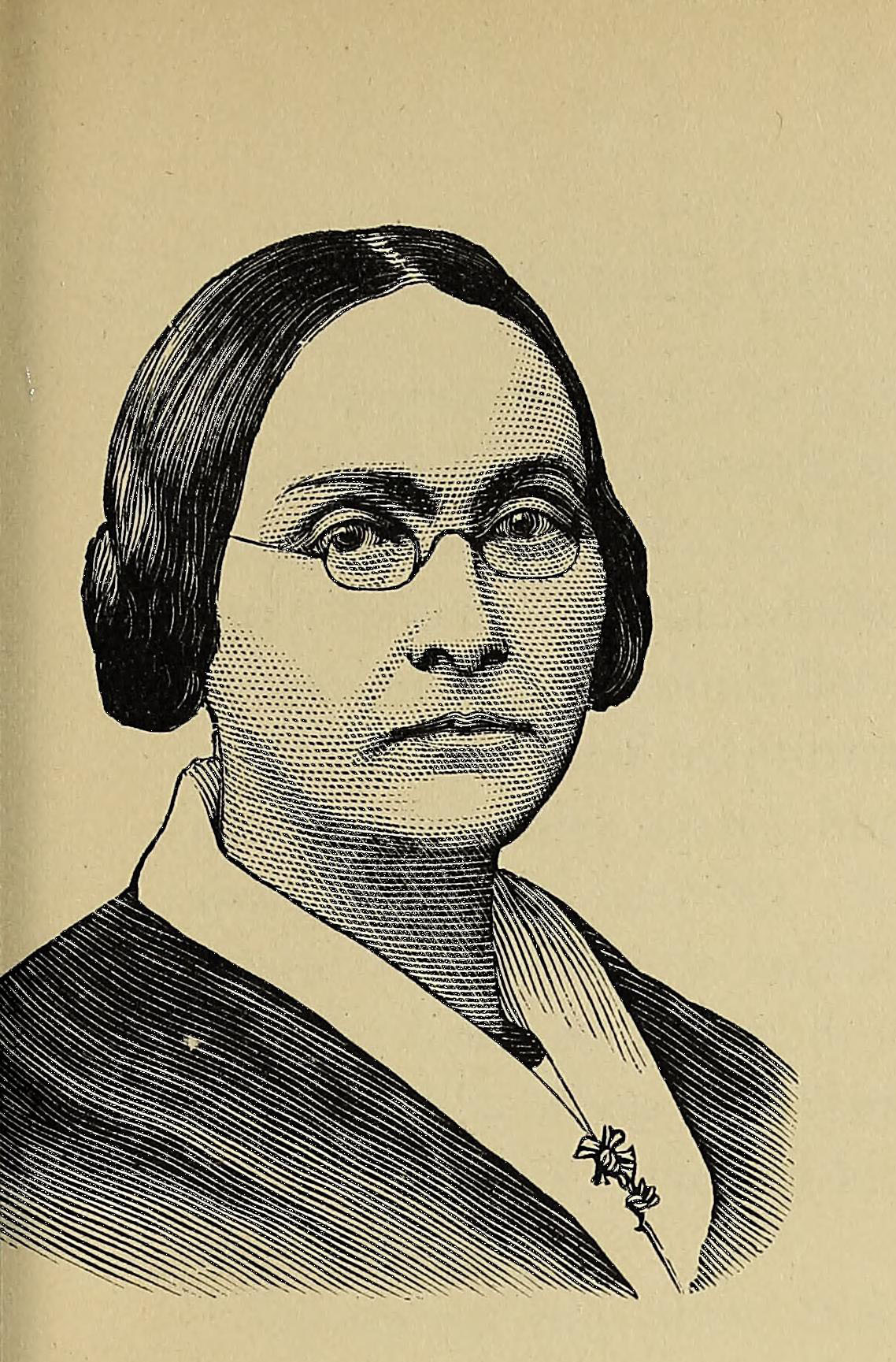 Black and white portrait of a person wearing glasses.